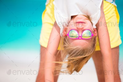 Little girl and her dad enjoy summer vacation at perfect beach
