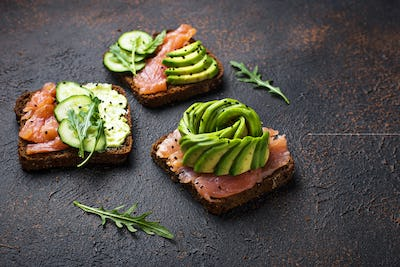 Healthy toasts with salmon and avocado rose