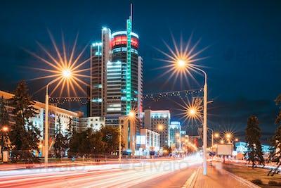 Minsk, Belarus. Night Traffic On Illuminated Street Pobediteley