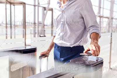 Close Up Of Passenger In Airport Departure Lounge Scanning Digital Boarding Pass On Smart Phone