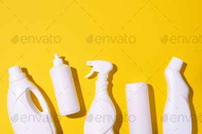 Cleaning products on yellow background. Top view. Copy space. Chemical cleaning supplies. Stop