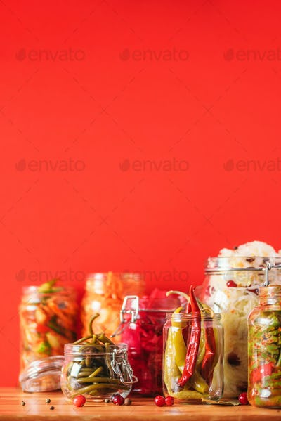Probiotics food background. Korean carrot, kimchi, beetroot, sauerkraut, pickled cucumbers in glass