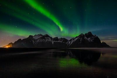 Northern lights at Vestrahorn Mountain and Stokksnes beach. Iceland