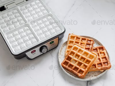 Breakfast belgian waffles and electric waffle maker