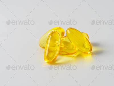 Omega 3 fish oil capsules isolated on white