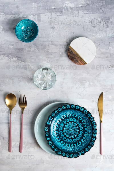 Flat lay of ceramic plate and cutlery utensils on grey background. Empty plate. ,food concept