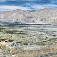 View of Nubra valley with Maitreya Buddha statue and Diskit gompa, Ladakh, India