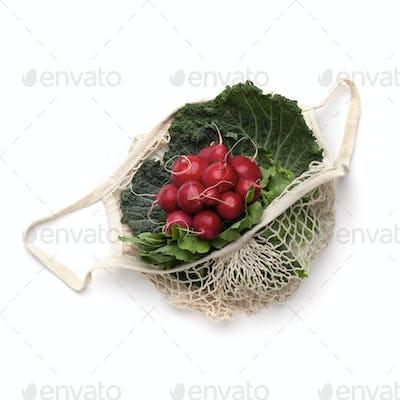 Reddish and green leaves for salad inside eco string bag