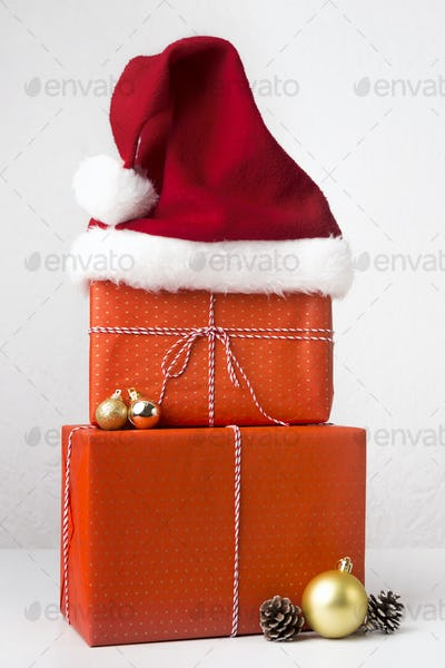 Close up of creative Christmas composition of gifts in Santa's hat