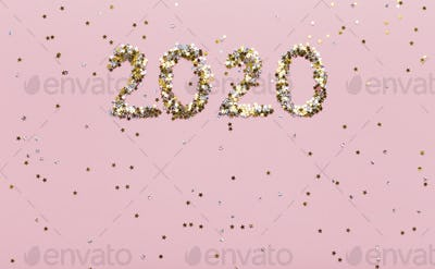 Super glowing background with gold 2020 of confetti on pink