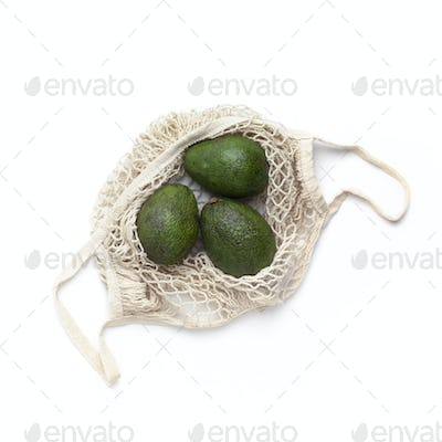 Fresh Avocado in eco bag for fruits and vegetables
