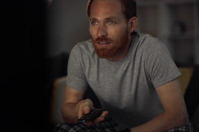 Excited Man Watching TV in Dark