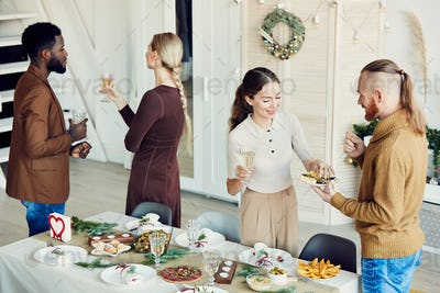 Group of People Celebrating Christmas in Dining Room