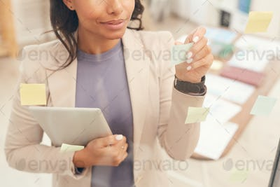 Businesswoman Planning Project by Glass Wall Background