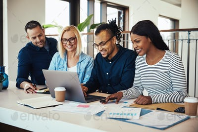 Diverse group of colleagues working together at an office table