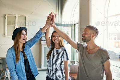 Enthusiastic business partners doing a high fives