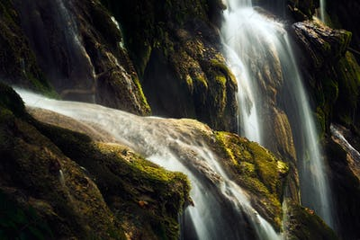 Details of a waterfall with moss aroung