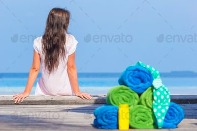 Beach and summer accessories concept - colorful towels, swimsuit and sunsblock background beautiful