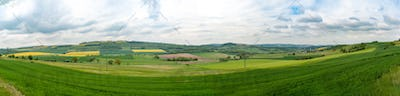 Day natural videangle view at German pastures and cornfields under blue cloudy skies spring time