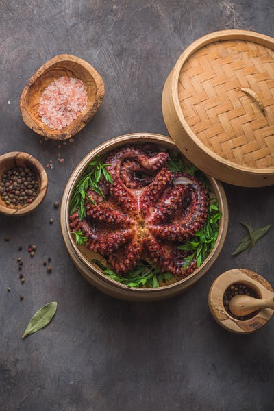 Big octopus in steamer with spices and herbs, close view