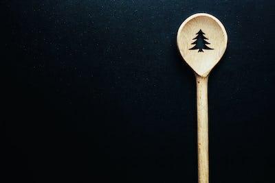 Christmas spoon on dark table