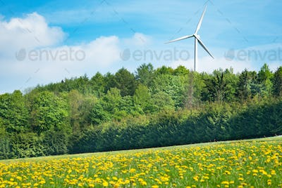 White generating electricity windmill under clear blue sky