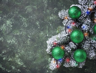 Christmas background with branch of tree and  balls