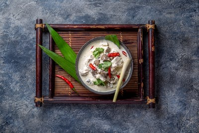Thai chicken mushroom coconut milk soup Tom Kha Gai in bowl with thai spices