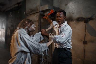 Man with pipe wrench kills female zombie, horror
