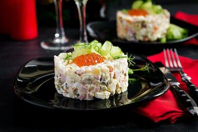 "Christmas table setting. Traditional Russian salad ""Olivier"". New Year salad. Festive salad."