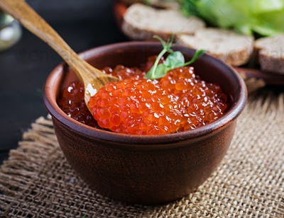 Salmon red caviar in bowl. Delicious food.