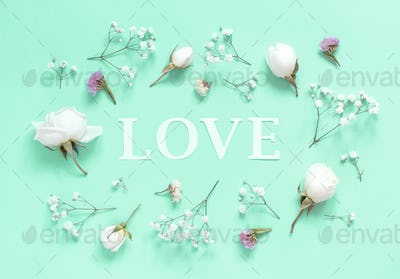 Flowers and word Love on a light green background