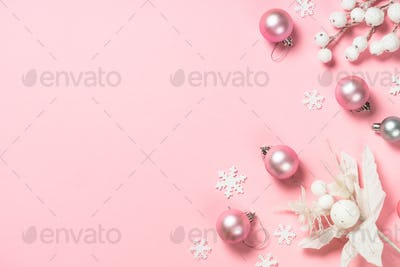 Christmas flat lay background with pink and white decorations on pink