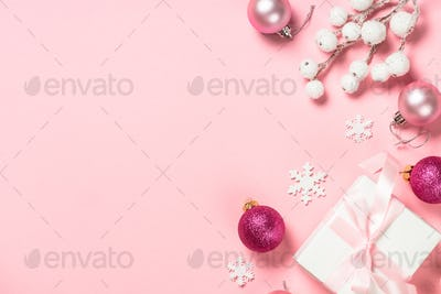 Christmas present box and decorations on pink background