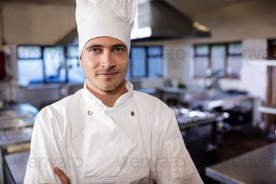 Male chef standing in kitchen at hotel