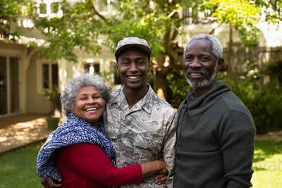 Portrait of soldier with parents