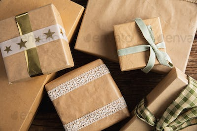 Simple wrapped gifts on wooden table