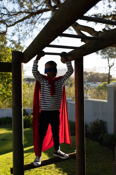 Superhero boy in garden