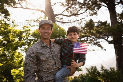 Portrait of soldier with son