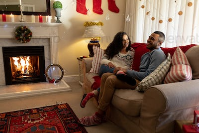 Couple at home at Christmas time