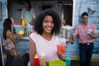 Portrait of beautiful woman having juice