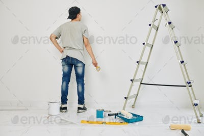 College student painting walls