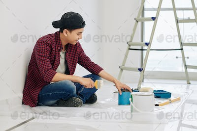 Man mixing wall paints