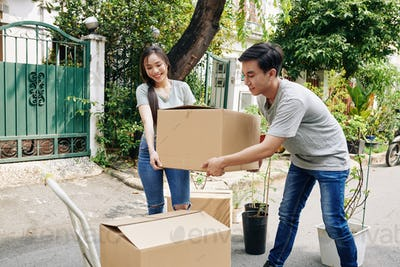 Young couple moving out