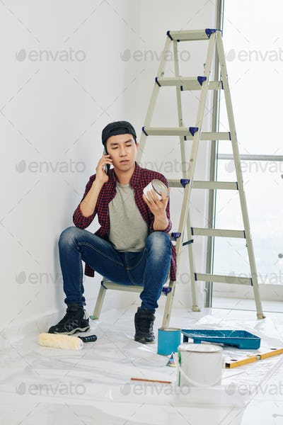 Man ordering white paint on the phone