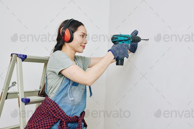 Woman remodeling new apartment