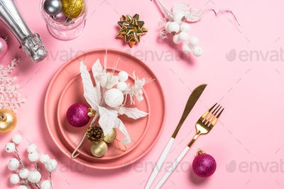 Christmas table setting on pink top view