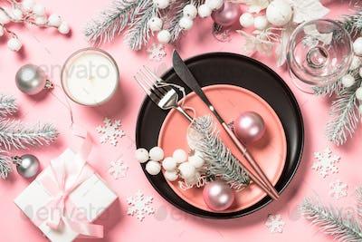 Christmas table setting on pink top view