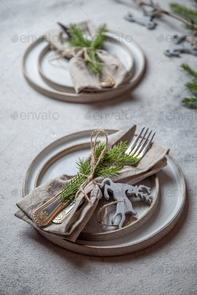 Cristmas table cutlery set with holiday decoration. Top view, copy space.