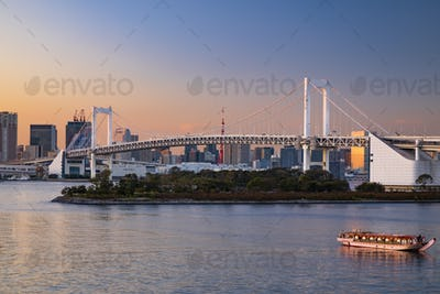 Rainbow Bridge and Sumida River in Tokyo, Japan. Night photo
